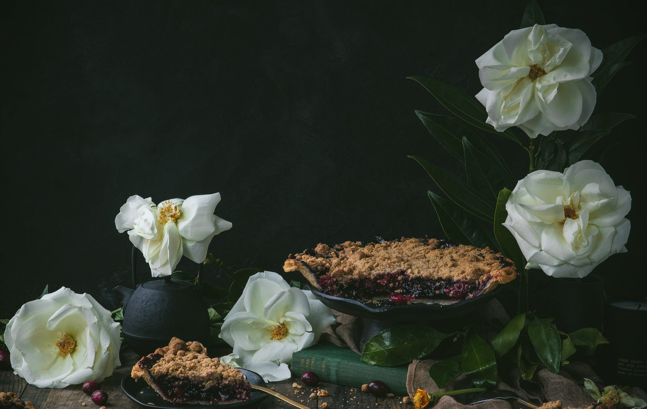 still life photograph with white flower and kettle