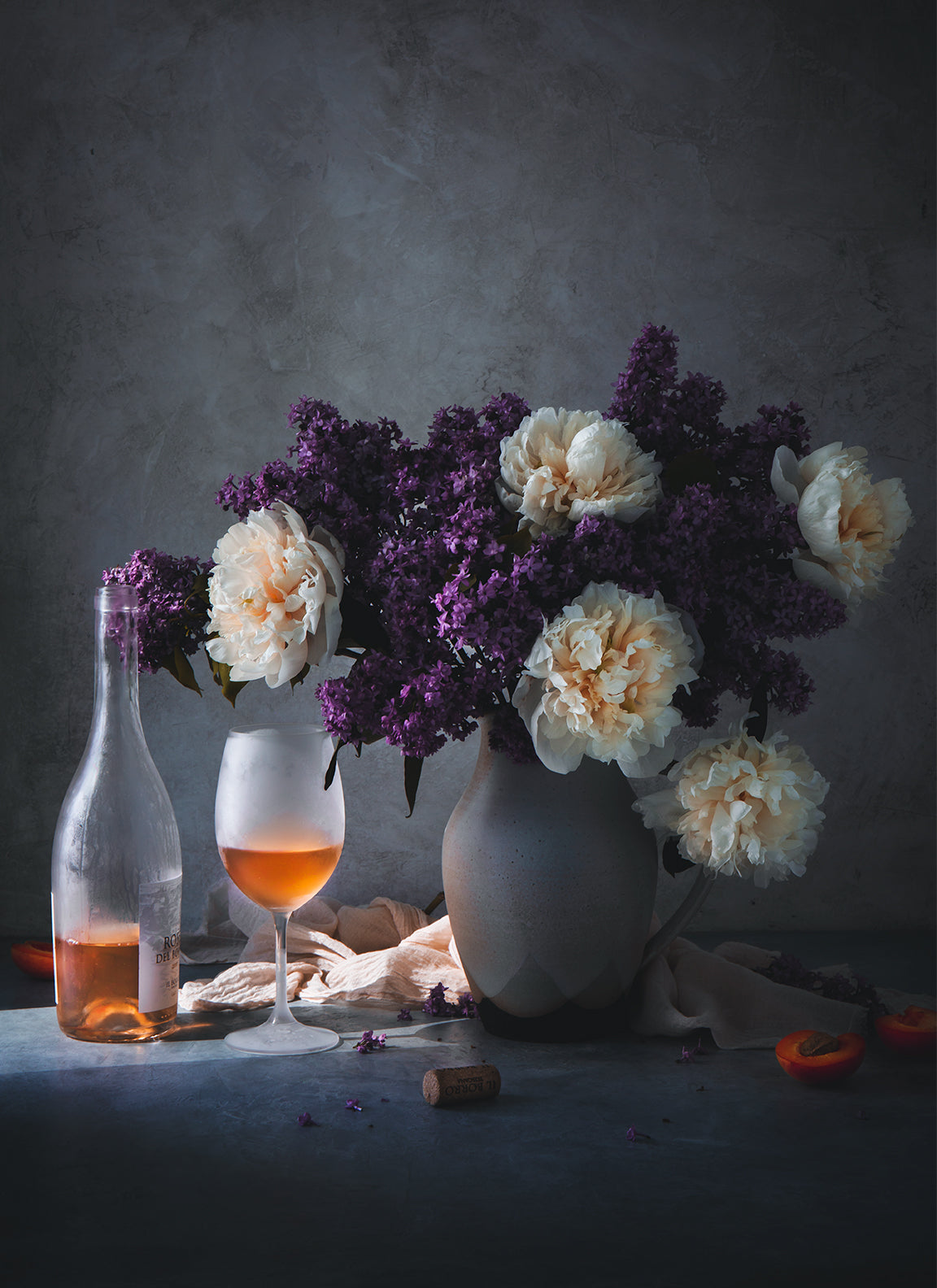 still life photograph of purple and white pink flowers and rose wine