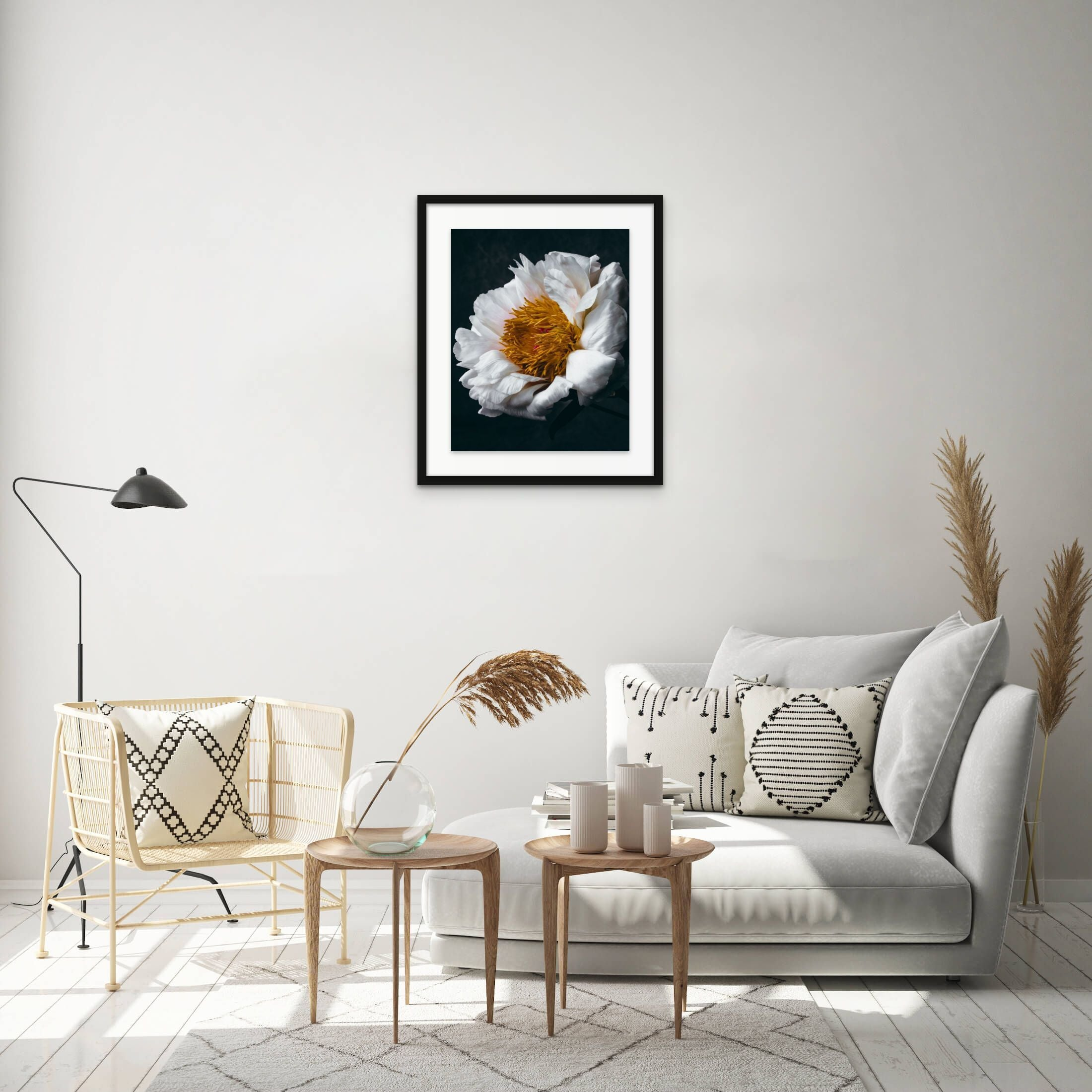 framed white and yellow flower art photo on wall above sofa and chair