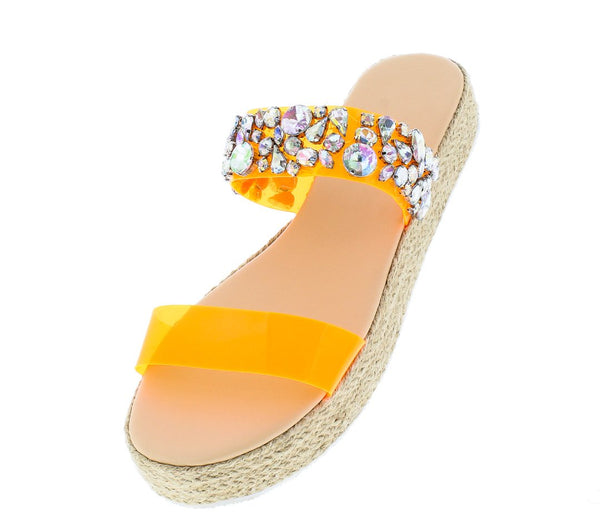 c5c81acded9 ... these slides are sure to turn heads! Features an open toe paired with  an open back. A large bow detail. A lug sole and molded foot bed.