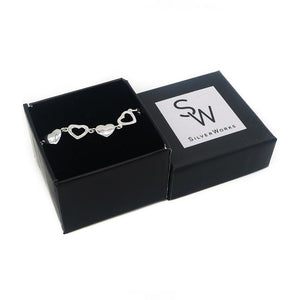 Load image into Gallery viewer, Charlotte Silver Bracelet with Alternate Cutout Heart Pendant Box Packaging