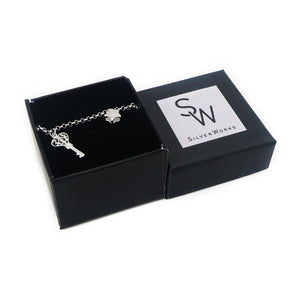 Chaya Silver Bracelet for Women with Puff Heart, Ball, Star, Key and Lock Charms Box Packaging