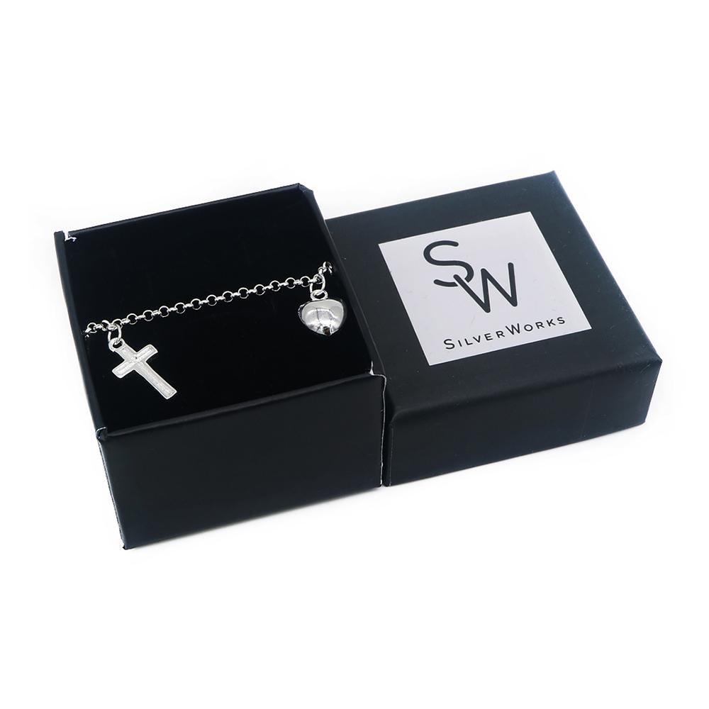 Load image into Gallery viewer, Cosette Silver Bracelet with Cross and Puff Heart Charms Box Packaging