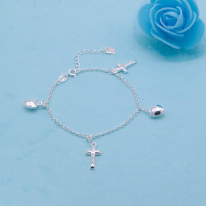 Load image into Gallery viewer, Cosette Silver Bracelet with Cross and Puff Heart Charms