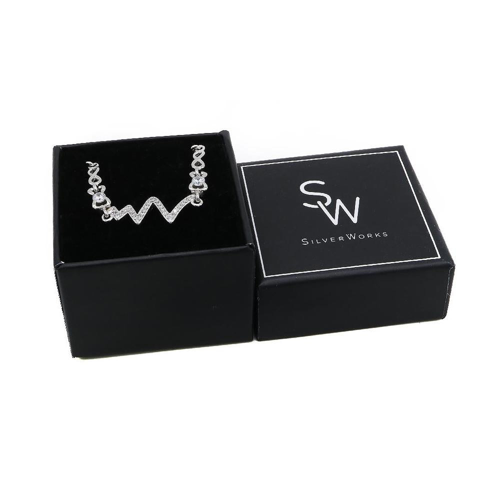 Load image into Gallery viewer, Consuelo Silver Pulse, Ribbon and Infinity Charms Bracelet with Simulated Diamonds Box Packaging