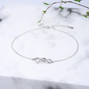 Clodagh Silver Open Heart and Infinity Charms Bracelet with Cable Chain 2
