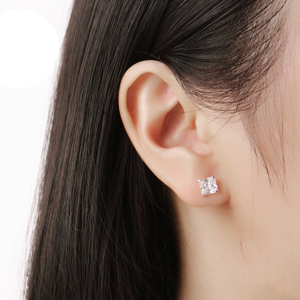 Malin Four-Prong Silver Stud Earrings on Model