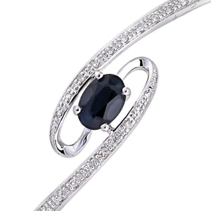 9ct White Gold 0.10ct Diamond And Sapphire 4 Claw Set Whirlpool Bangle