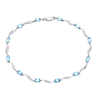 9ct White Gold Blue Topaz and Diamond Wave Link Bracelet