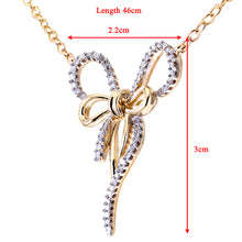 "Load image into Gallery viewer, 9ct Yellow and White Gold Pave Set Diamond Bow Pendant and 18"" Chain"