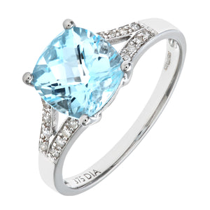 9ct White Gold Cushion Cut Blue Topaz Ring With Diamond Shoulders