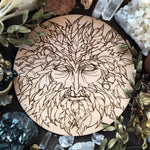 Wooden pentacle with engraving Green Man related to natural vegetative deities. Symbol of rebirth.