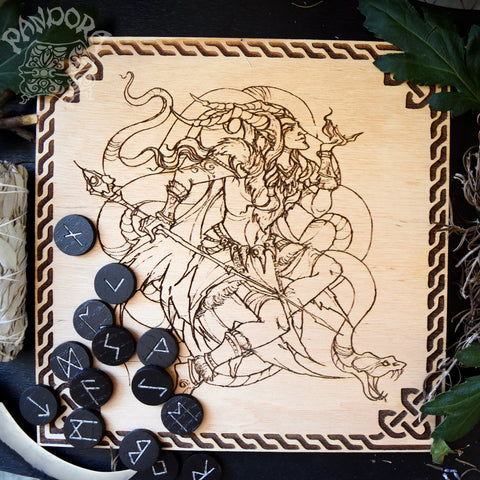 Wooden pentacle with engraving god Loki from Norse mythology.