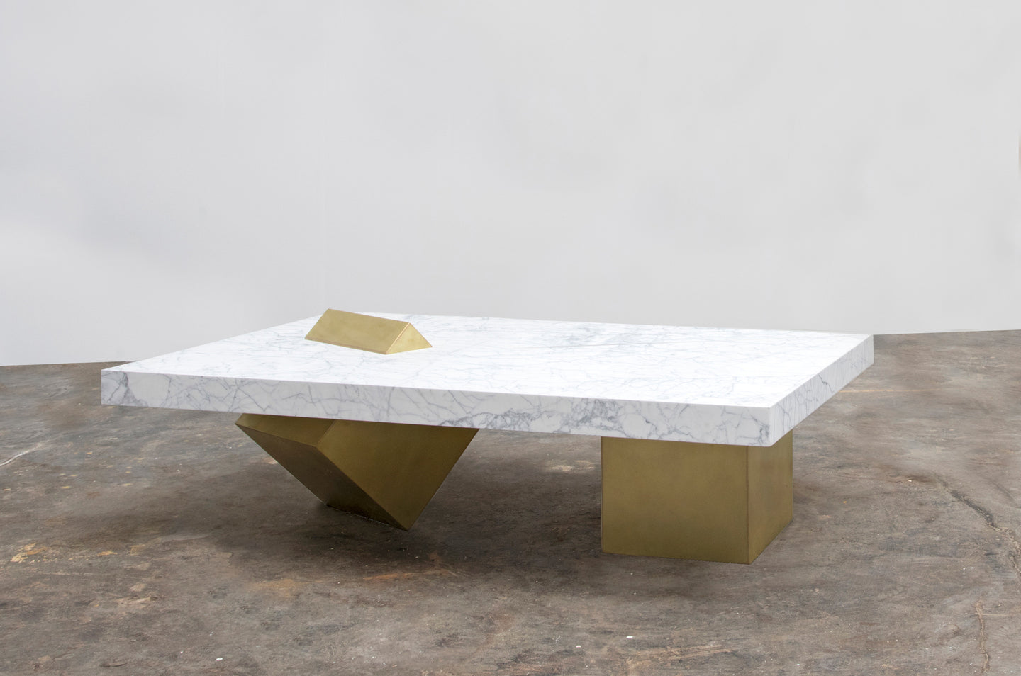 The Coexist Coffee Table made of marble and brass