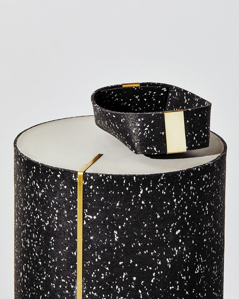 Small speckled black rubber basket on speckled black rubber CYL side table.