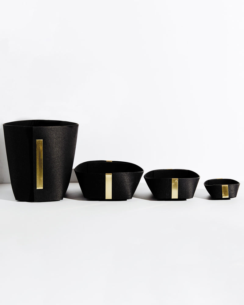 Rubber & brass bin, large, medium and small black rubber & brass basket lined up on white background.