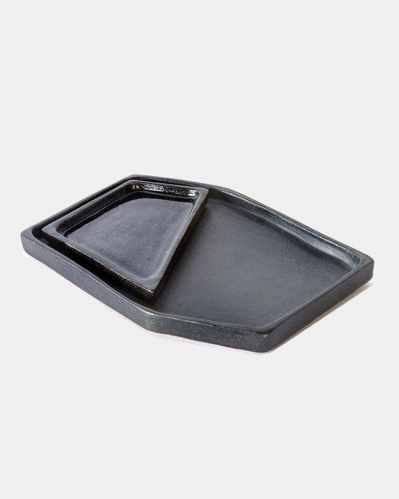 Matte black and glossy black ceramic nesting tray on white background.