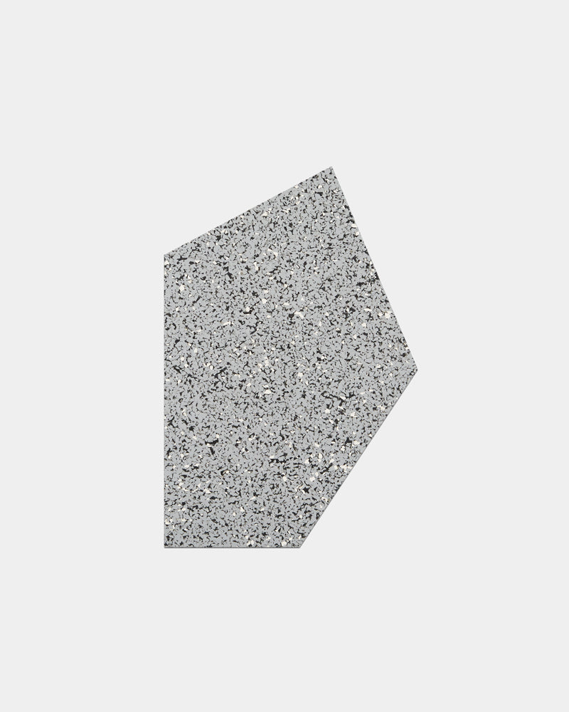 Geometric gem shaped speckled grey rubber mousepad on white background.