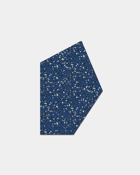 Geometric gem shaped speckled blue rubber mousepad on white background.