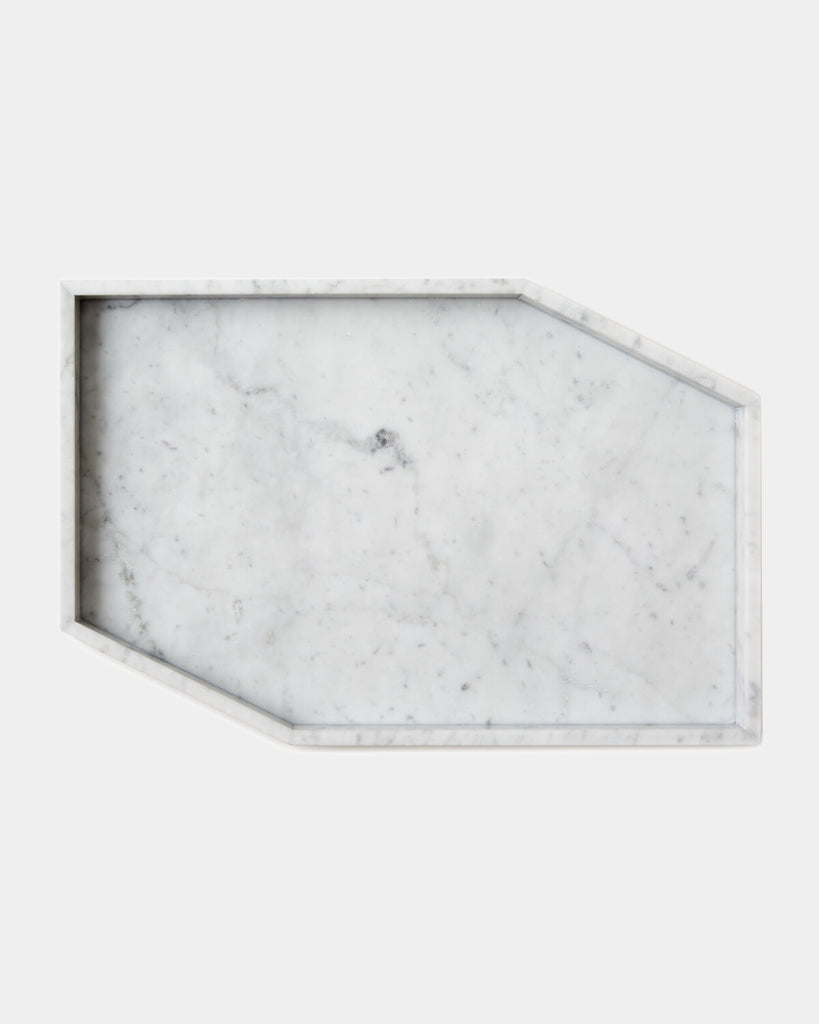 White geometric marble tray on white background.