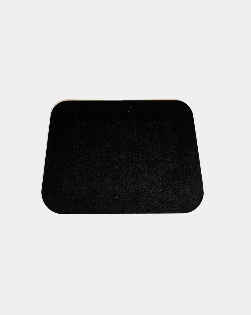 Rounded corner black rubber desk mat on white background.