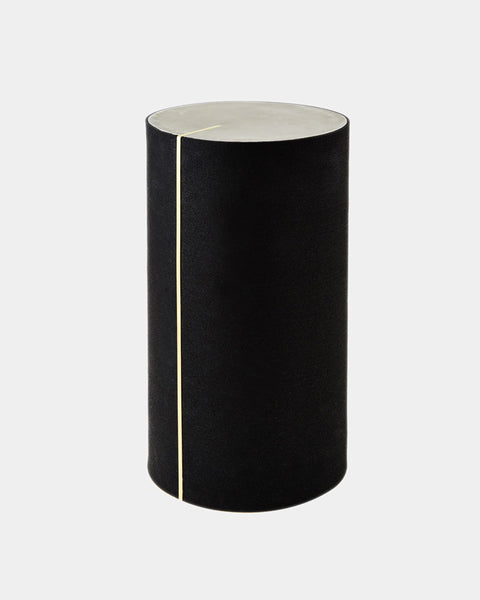 Round side table with black rubber, brass strip and concrete table top.