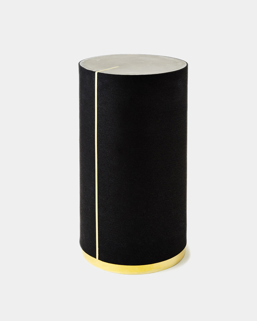 Round side table with black rubber, brass strip, brass base and gray concrete table top.