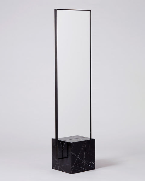 Standing mirror with nero marquina cube base and rectangular blackened steel mirror frame.