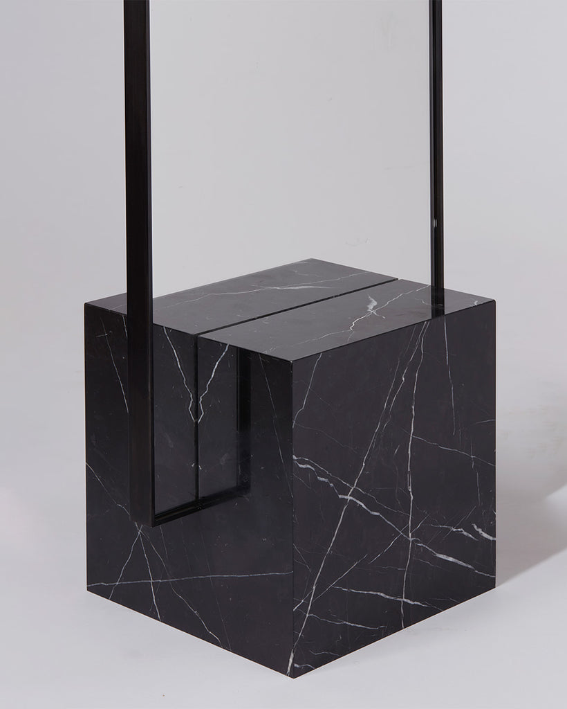 Cube base detail image of standing mirror with nero marquina marble base and blackened steel mirror frame.