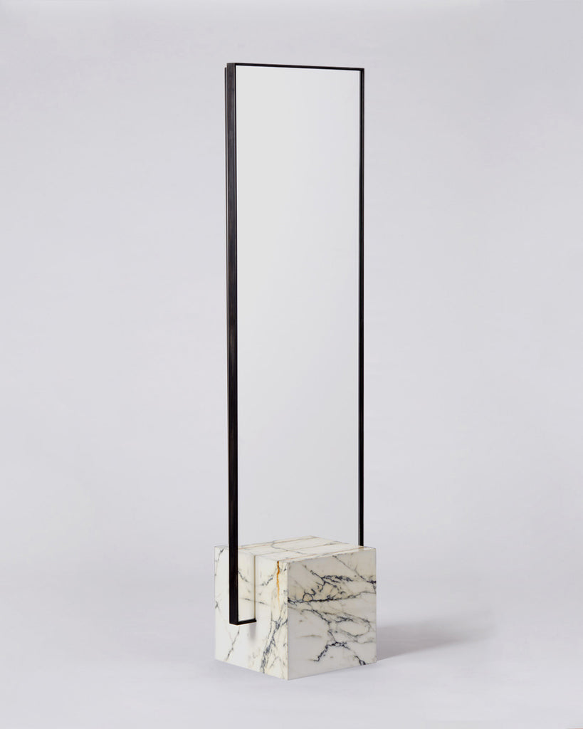 Standing mirror with white marble cube base and rectangular blackened steel mirror frame