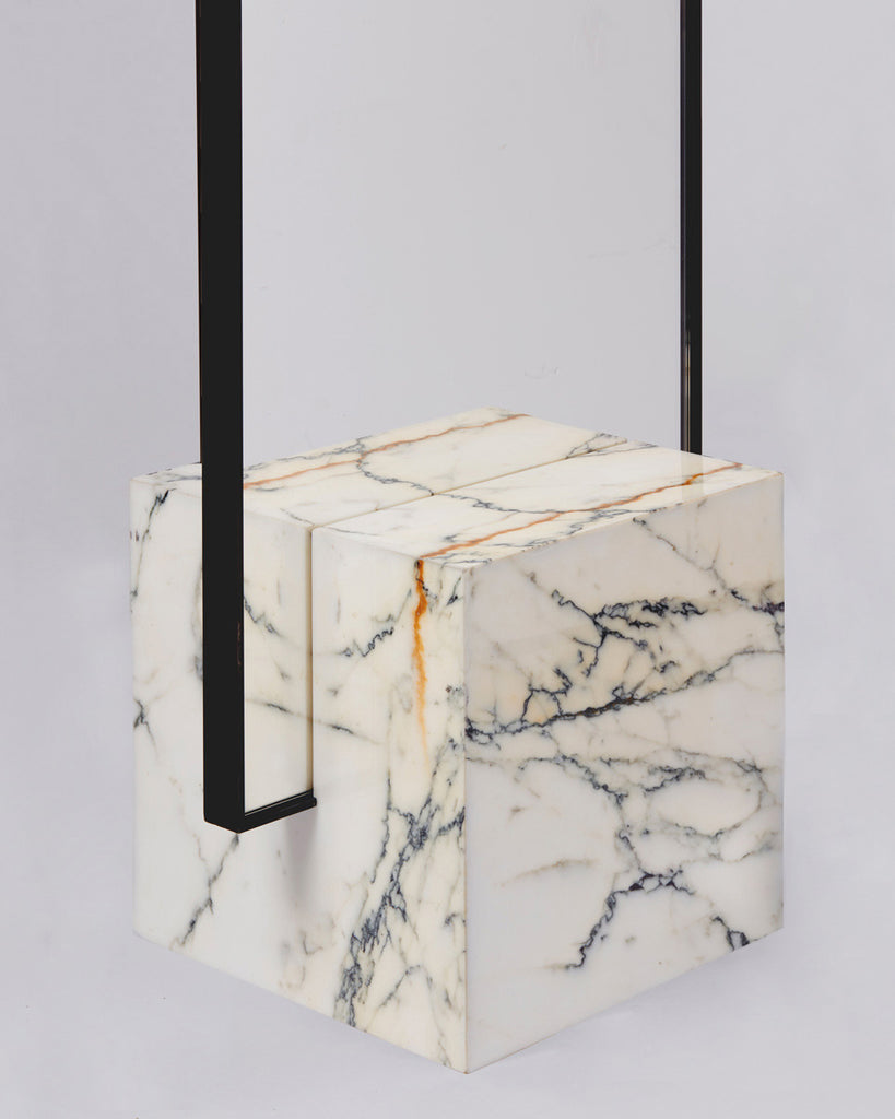 Cube base detail image of standing mirror with white marble base and blackened steel mirror frame