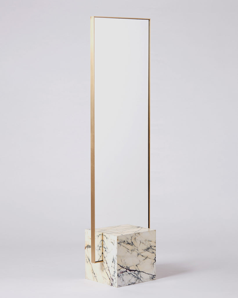 Standing mirror with white marble cube base and rectangular brass mirror frame