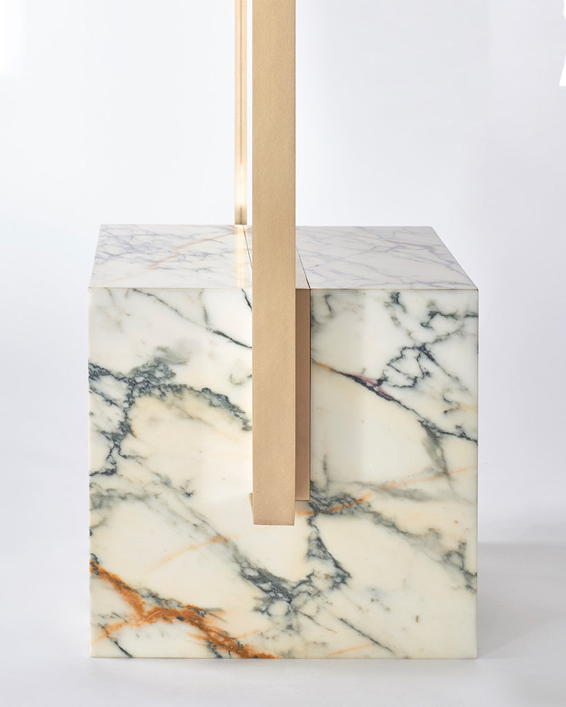 Cube base detail image of standing mirror with white marble base and brass mirror frame