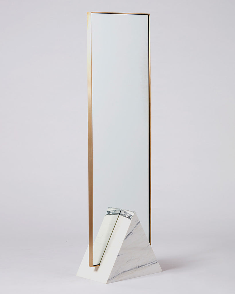 Standing mirror with white marble triangular base and rectangular brass mirror frame.