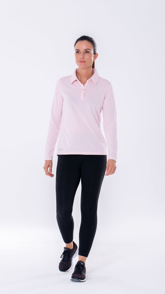 Antiviral and antibacterial women's long sleeve light pink polo, a classic fit made of lightweight high quality yarns for breathability and comfort.