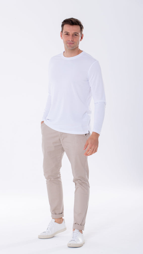White long sleeve shirt made of lightweight breathable fabric, wearable while exercising, at work or on your day-to-day errands.