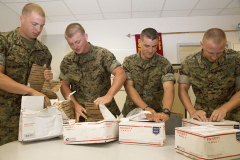 Troops opening packages