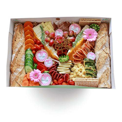 a birthday box full of cheese, meat, vegetable, fruits, dips, jam, flower