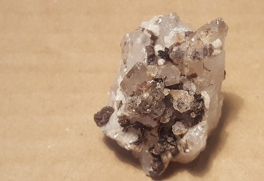 Hubeite on Quartz specimen