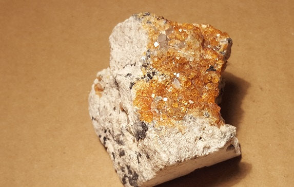 Spessartite on microcline specimen