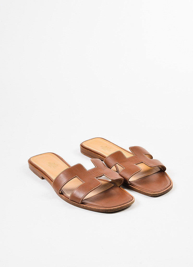 "Brown Hermes Leather ""Oran"" Logo Slide Sandals Front"