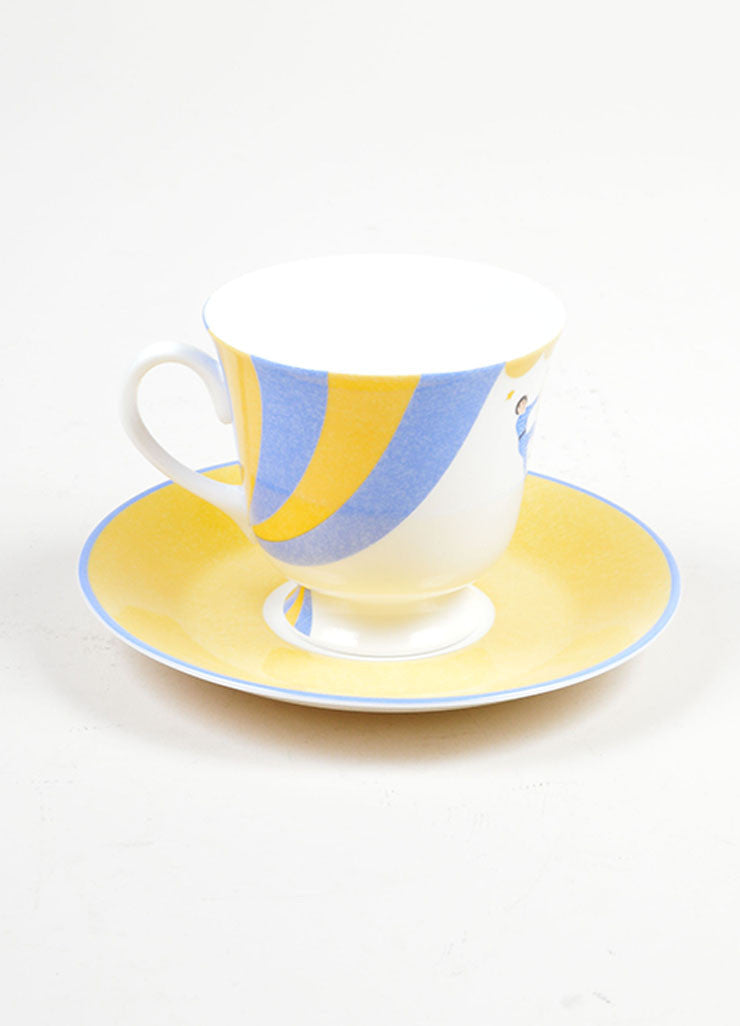 "White, Yellow, and Blue Hermes Porcelain ""Les Trapezistes"" Circus Teacup and Saucer Frontview"