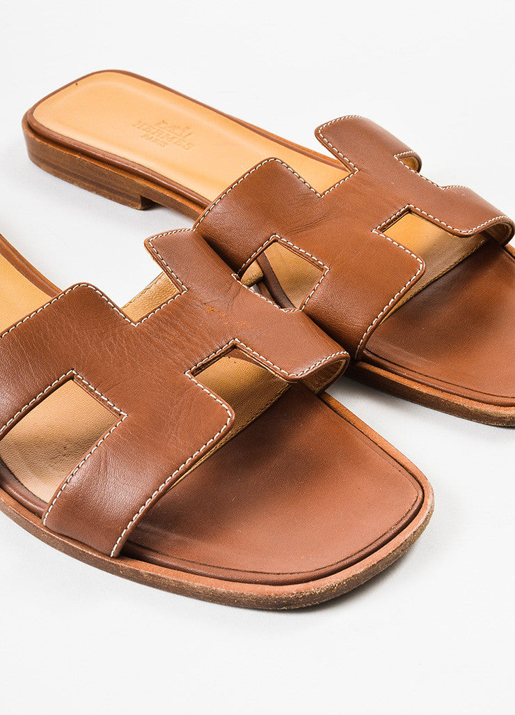 "Brown Hermes Leather ""Oran"" Logo Slide Sandals Detail"