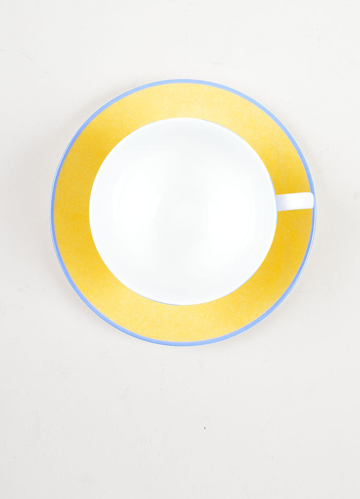 "White, Yellow, and Blue Hermes Porcelain ""Les Trapezistes"" Circus Teacup and Saucer Topview"