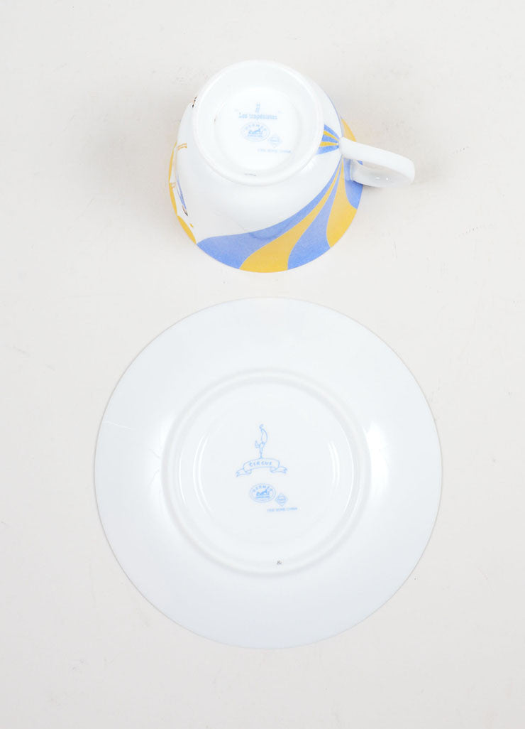 "White, Yellow, and Blue Hermes Porcelain ""Les Trapezistes"" Circus Teacup and Saucer Bottom View"