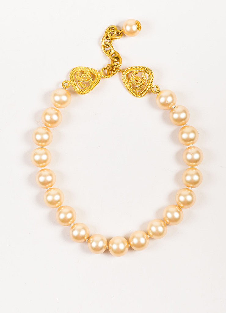 Chanel Gold Toned Plated Metal and Faux Pearl 'CC' Rope Detail Necklace Frontview