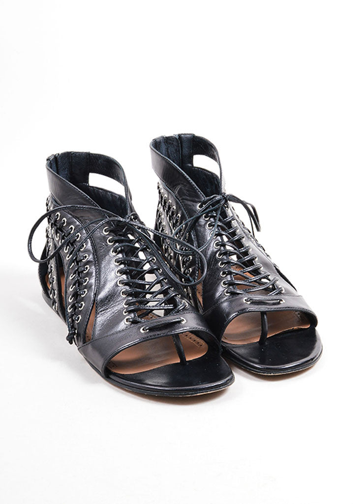 Alaia Black Leather and Silver Toned Grommet Lace Up Open Toe Sandals Frontview