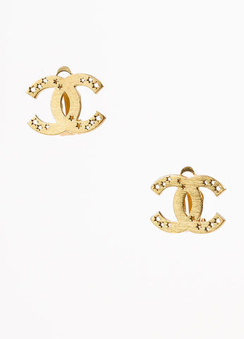 Chanel Matte Gold Toned Star Cut Out 'CC' Logo Clip On Earrings Frontview
