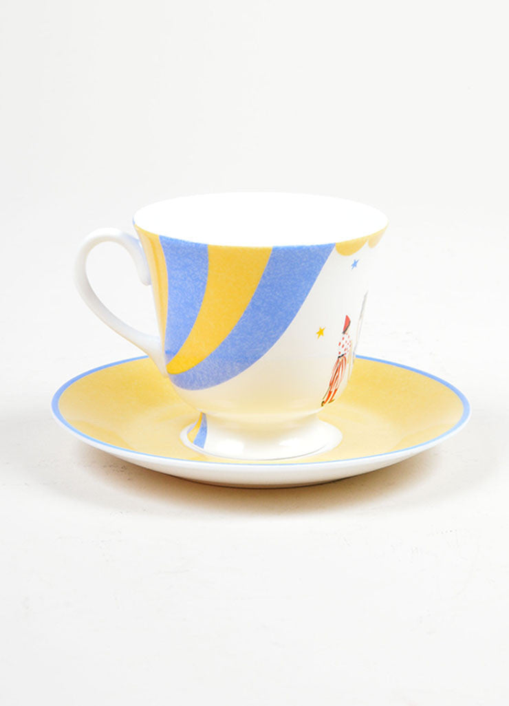 "White, Yellow and Blue Hermes Porcelain ""Le Clown Dresseur"" Circus Teacup & Saucer Front"