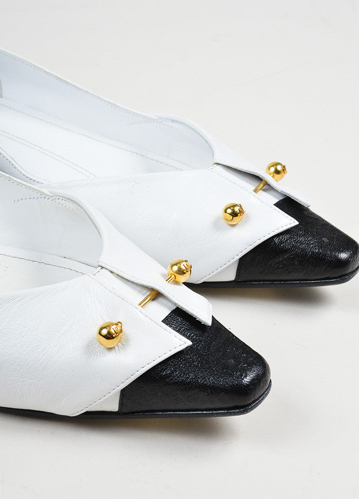 White, Black, and Gold Toned Chanel Tuxedo Collar Barbell Flats Detail